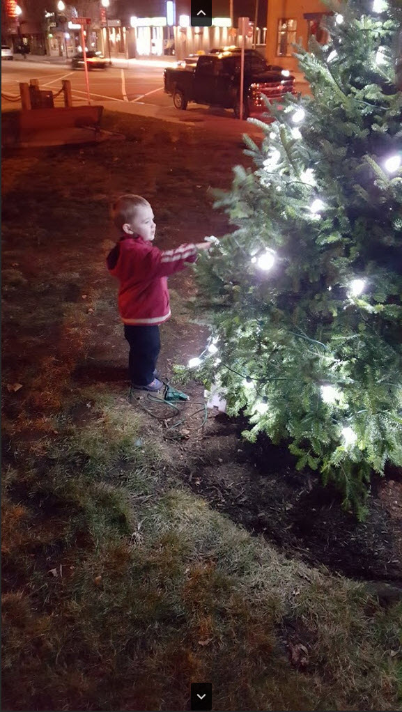 Boy with Lit Tree